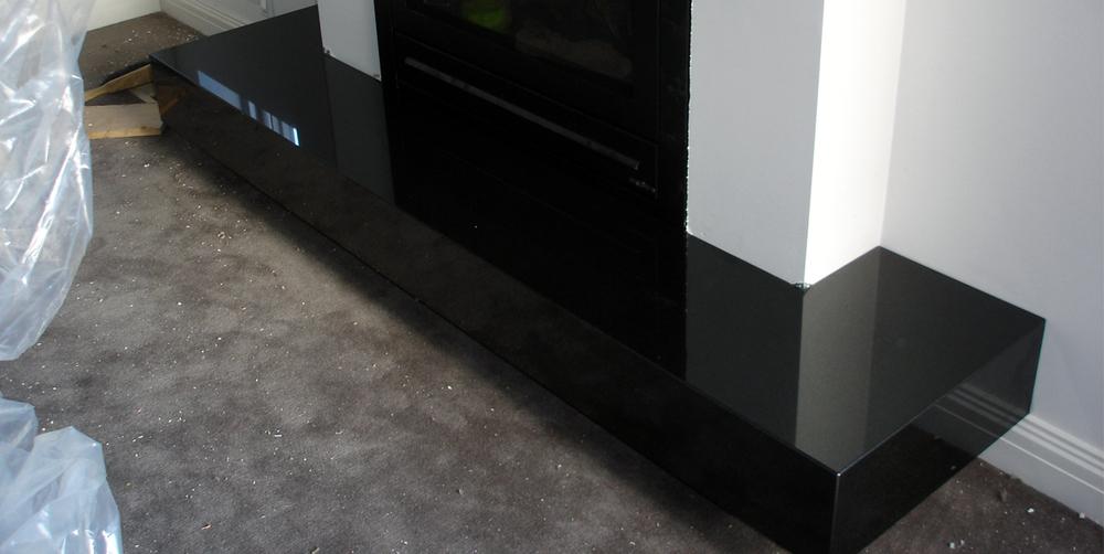 fireplace zimbabwe black granite stonemasons melbourne. Black Bedroom Furniture Sets. Home Design Ideas